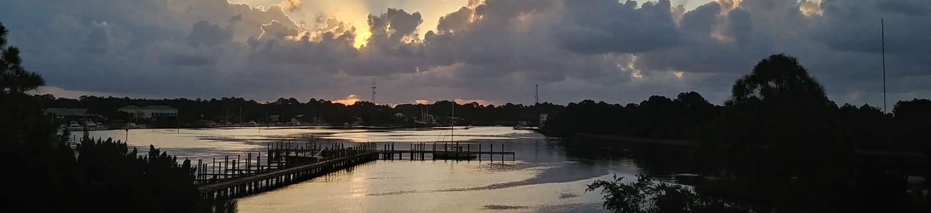 Harbor sunrise seen from Carrabelle bridge Header